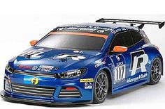 The Tamiya Volkswagen Scirocco GT24 FF-03 is a 1/10 scale radio control car on the famous FF-03 chassis. The 2008 24 Hours Nurburgring had Volkswagen debut a contingent of new Scirocco GT24 race cars. They went on to earn an impressive 1-2 finish in their inaugural race. The Tamiya R/C car model is produced in 1/10 scale and the featured chassis underneath is the FF-03 (Tamiya's 3rd generation Front-Wheel-Drive chassis).