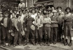 """November 1913. New Orleans, Louisiana. """"Group of workers in Lane Cotton Mill showing the youngest workers and typical of conditions in New Orleans. Violations of the law are rare."""" Photo by Lewis Wickes Hine."""