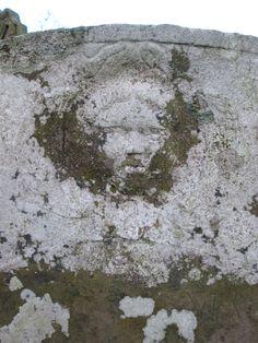 lichen encrusted cherub, 18th century, Welsh Newton.