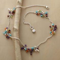 """tiny """"islands"""" of tropical-colored gemstones joined by bridges of dainty sterling silver chain - such a cute necklace"""