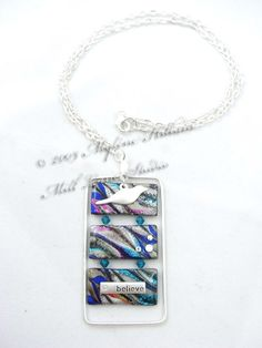 Marbled #FriendlyPlastic, coated with resin and strung with Swarovski crystals and silver findings