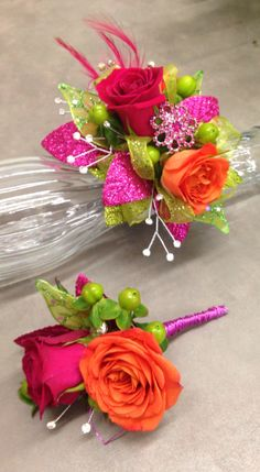 The Katy perry wrist corsage and matching bout. Hot pink and orange spray roses., hot pink and lime green accents with bling and feathers Prom Corsage And Boutonniere, Diy Boutonniere, Corsage Wedding, Corsages, Wrist Flowers, Prom Flowers, Wedding Flowers, Homecoming Corsage, Hot Pink Weddings