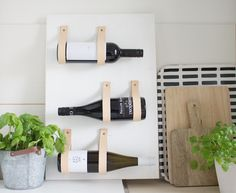 When simplicity is key, less is more. All you'll need for this minimalist  wine rack is a wooden board, leather straps, some paint,screws and a  leather punch. Choose the size of your wood board based on the size of your  kitchen and how many wine bottles you wish to store. A 60cm x 40cm is show