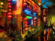 Lanterns illuminate a quiet corner of the Old Town of Lijiang, China