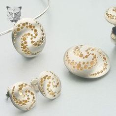 Caged beads roll around inside hollow forms