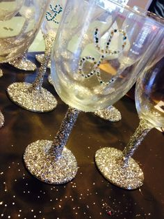 """DIY baby shower decorated wine glasses I'll be filling these up with Hershey's that say """"it's a boy!"""" And placing them in the tables:)"""