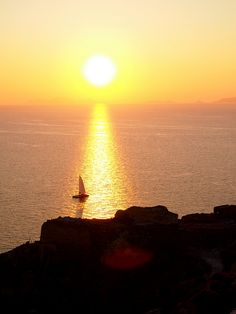 A yellow sunset, Oia, Santorini, Greece #southbeachswimsuitsmostwanted #southbeachswimsuits