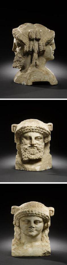 A Roman marble janiform herm Neo-Attic, circa 1st Century B.C./A.D.