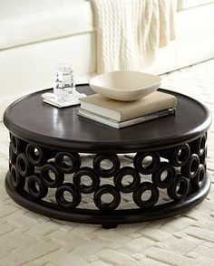 Arteriors Black Walnut Cocktail Table: Unusual circular coffee table has a hand-carved border of mod circles.    Hand carved of mango wood with a hand-applied dark walnut finish.    31
