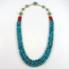 Three Strand Bead Necklace with Hand Rolled Turquoise and Coral Beads. This stunning necklace features hand rolled, natural high grade turquoise beads from the Bisbee turquoise mine in Arizona and Oxb