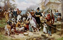 The First Thanksgiving 1621, oil on canvas by Jean Leon Gerome Ferris (1863–1930). The painting shows common misconceptions about the event that persist to modern times: Pilgrims did not wear such outfits, and the Wampanoag are dressed in the style of Plains Indians.[9]