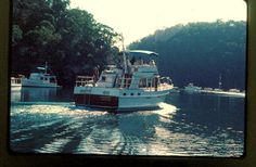 SUZANNE 1 (44 Island Gypsy Flush Aft Deck) leaves Halvorsens at Bobbin Head.