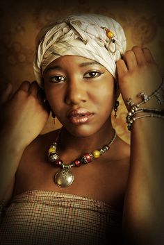 Love the head wrap and like the make up too!
