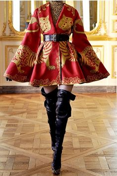 #Alexander Mcqueen- I love the cape effect of this garment. It is a very interesting and innovative shape.