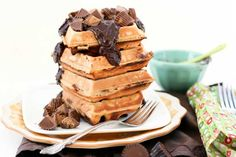 Reeses Peanut Butter Chocolate Waffles  These waffles are made with Peanut Butter and actual mini Reese's Peanut Butter Cups mixed straight into the batter. Topped with a Chocolate Ganache Glaze, and some more mini Reese's, this breakfast-dessert will have you wanting more.