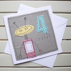 This cute, one-off, handmade 4th birthday card has been designed and made by myself using the technique of free motion machine embroidery. It is lovingly made to create a really special birthday card for a little one to celebrate their big day. Individual pieces of fabric have been