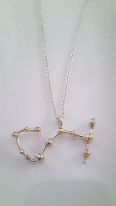 The Scorpius constellation has intrigued people for centuries, not only for its distinctive shape, but also because it is one of the brightest Scorpio Star Constellation, Constellation Necklace, Handmade Necklaces, Handmade Gifts, Star Constellations, Addiction, Pearl Necklace, Brass, Shape