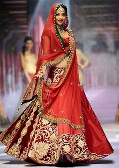 Indian bridal lehenga. Indian wedding outfit, red lehenga