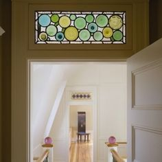 Transom Windows. The panels  doors in old homes, especially those built in the Arts and Crafts styles. They admitted natural light to front hallways and interior rooms before the advent of electricity, and circulated air even when doors were closed for privacy.