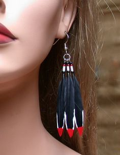 Painted Woodpecker Feather Earrings by wildspirits on Etsy, $30.00
