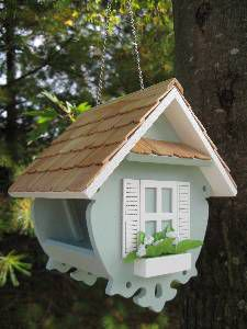 a delightful bird feeder from Susan Branch... love her wesite and artwork.  Also love her calendars!