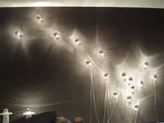The simple La Plic light attached to the wal via a wire cradle was designed by Nathalie Dewez in One would simply not be enough. Light Art, Light Bulb, Modern Lighting Design, Light Design, Wall Lights, Ceiling Lights, Ligne Roset, Light Installation, Lighting Solutions