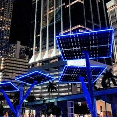 We are very excited to have worked with @SpotlightSolar to help showcase the growth of renewable energy in Florida. The solar tree structures produce renewable energy throughout the day and the LED neon adds a new dynamic to the Miami skyline at night. The stunning solar structure can be found along Bayfront Park in Downtown Miami! #LEDneon #architecturallighting #lightingdesign #renewableenergy #LEDlighting Led Light Projects, Tree Structure, Miami Skyline, Downtown Miami, Light Architecture, Renewable Energy, Lighting Design, Skyscraper, Solar