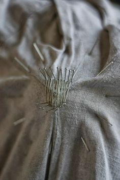 Medieval Silkwork: Mending an old shirt by weaving a small piece of new fabric directly fixed on the base fabric of the garment. I'm not sure whether there is any proof of this method used in medieval times.