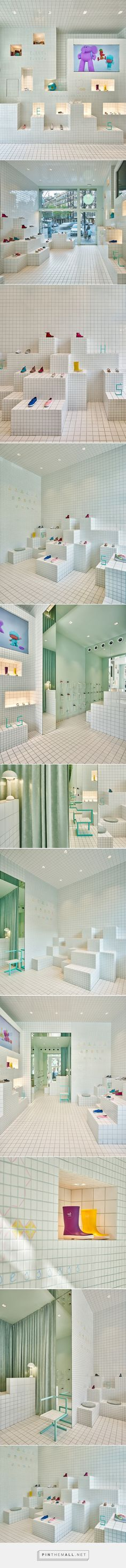 nabito architects covers children's shoe shop in barcelona with a grid of tiles - created via http://pinthemall.net