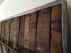 Custom wall-art piece made from repurposed oak whiskey barrel wood and staves. Material Resourcers RECLAIM - RETHINK - RESOURCE Salt Lake City, Utah