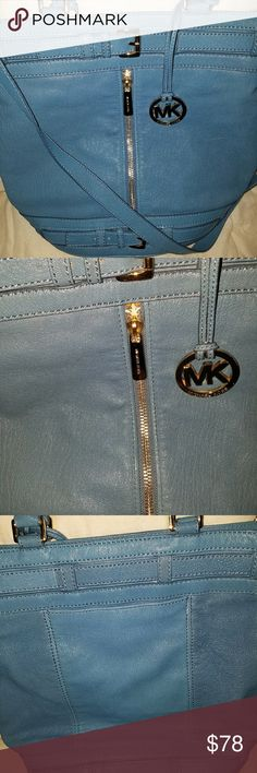 Michael Kors Bag Teal Medium sized bag. Gold zip down middle portion of the purse. Leather material. Inside zip and slip pockets. Michael Kors Bags Shoulder Bags
