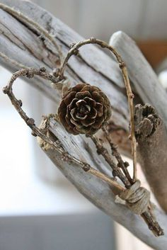 Simple larch twig and cone heart. Nice idea to make and attach to a gift.