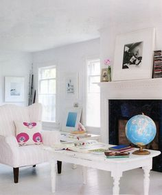 All white rooms with colorful textiles and art
