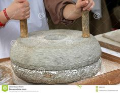 Photo about Ancient millstone for grinding wheat and seeds to make flour. Primitive Kitchen, Rustic Kitchen, Vintage Kitchen, Traditional Kitchen, Traditional House, Distilling Equipment, Happy Kitchen, Cooking Equipment, Natural Health Remedies