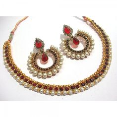Buy Maroon Pearl Stone Tilak Polki Necklace Set Online at cheap prices from Shopkio.com: India`s best online shoping site