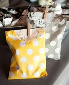 Make your own favor bags with sweet little baggies and clothespins and doilies. All these things can be purchased in bulk online or at the dollar store