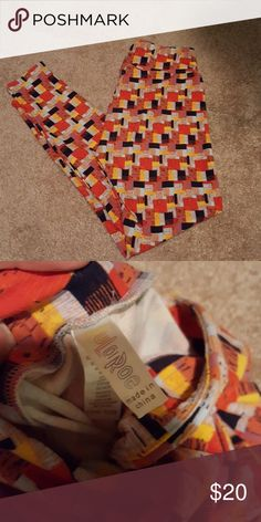 OS Lularoe geometric print leggings These are a pair of lularoe leggings with a multi colored geometric pattern on them. They're in very good used condition from a smoke-free home. They do not have any rips, holes, tears, chub rub, or anything else that I am seeing wrong with them. They were washed per lularoe instructions. LuLaRoe Pants Leggings