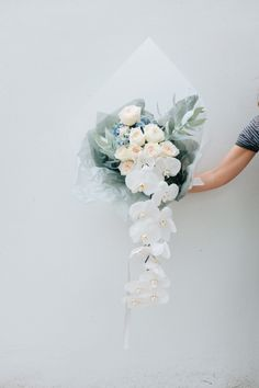 white bridal bouquet with cascading orchids