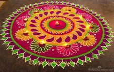 Simple and easy paisley rangoli design decorated with diya