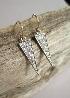 Glittering rough cut pave diamond arrowheads set in oxidized (blackened), rhodium plated sterling silver dangle from 14K gold fill earwires.
