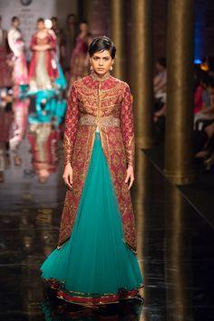Blue lehnga with plum purple jacket blouse by JJ Valaya at India Bridal Fashion Week. More here: http://www.indianweddingsite.com/bmw-india-bridal-fashion-week-ibfw-2014-jj-valaya/