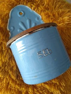 "Lovely piece. Great enamel in french blue. wooden lid.The french word ""Sel"" for salt in gorgeous letters.Please see pictures for condition. Some wear and rust due to age.enjoy our free shipping!Height 24 CM wide 15 cm"