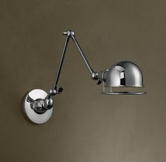 RH's Atelier Swing-Arm Wall Sconce:Our task-style sconce reconceives the high-focus functionality of tabletop task lighting  for the wall, with an extension arm that offers exact positioning. Crafted of enduring brass and steel, its reflector dome adjusts with a touch of the stay-cool positioning ring.