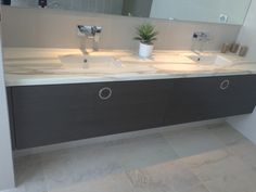 Calacatta Oro - vanity top with under mounted sinks.