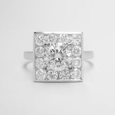 A 13 stone round brilliant cut diamond square channel set ring mounted in platinum. Engagement Rings Round, Dress Rings, Round Diamonds, Diamond Cuts, Stone, Channel, Jewelry, Rock, Jewlery