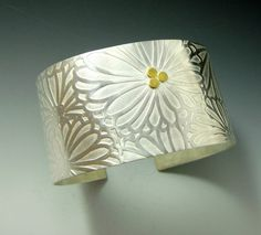 A 2 x 6 inch piece of sterling silver was placed into a rolling mill to imprint this great daisy pattern. MEMBER - Jewelry by Francine
