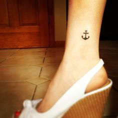 Cute Black Anchor Tattoo On Ankle