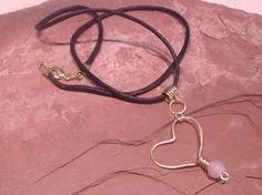Hammered heart gold tone with pink glass bead wire wrapped
