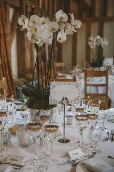 Orchid Centrepiece in The Great Barn Surrey - McKinley Rodgers Photography | Rustic Wedding at Gate Street Barn, Surrey | Suzanne Neville Wedding Dress | Pink Peony Bouquet | Story Catchers Films