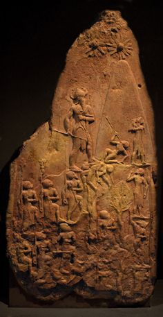 """Akkad: Sandstone Victory Stele (78"""") of Naram Sin (Sargon's grandson) king of Akkad, shows him protected by the luminaries of heaven & about to dispatch the last of his enemies, ca 2250 BC. Brought from Sippar to Susa in the 12th c. BC. Restored in 1992 AD. Louvre"""
